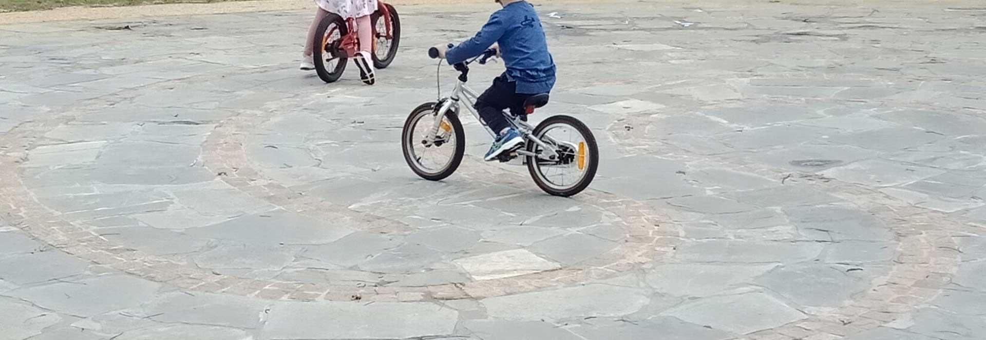 Children Bike Riding the Bunbury Garden Labyrinth